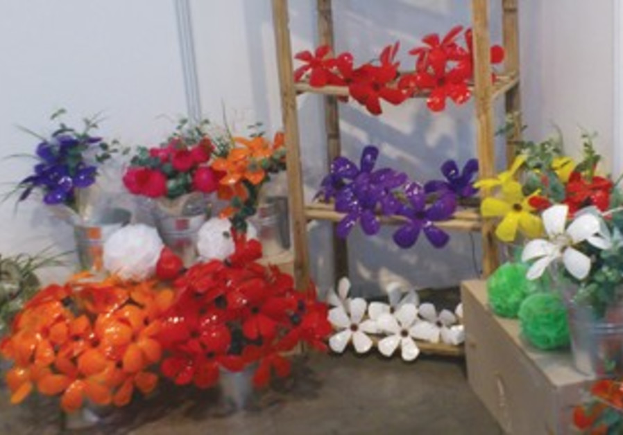 FLOWERS MADE out of recycled materials are on display at the CleanTech exhibit in Tel Aviv