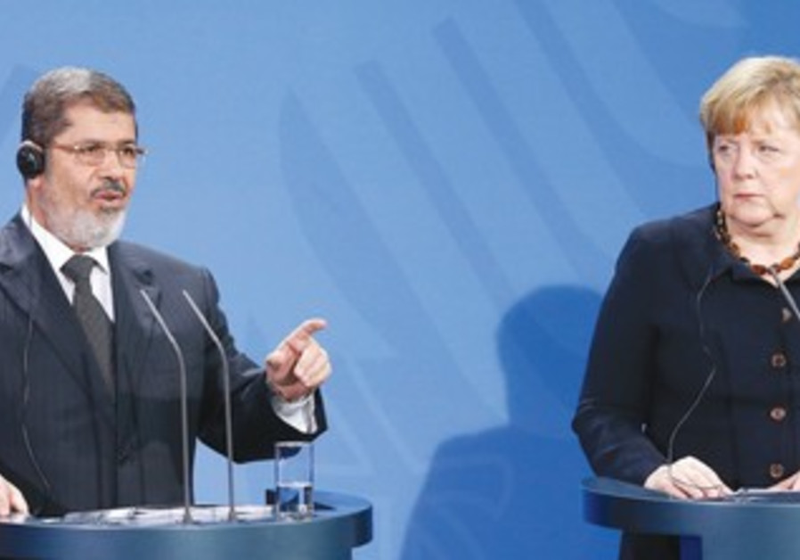 Morsi and Merkel and press conference in Berlin, January 31, 2013
