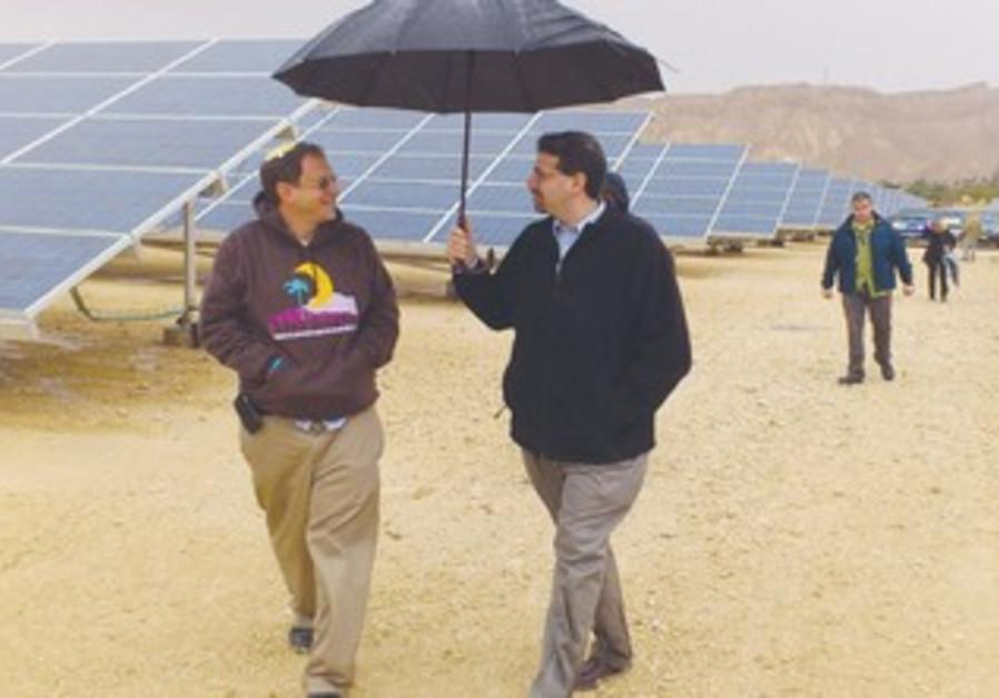 US AMBASSADOR Daniel Shapiro (right) shares an umbrella with Arava Power president Yosef Abramowitz