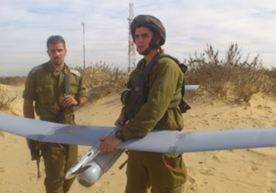 Sec.-Lt. Itzik Cohen holds a Sky Rider drone before takeoff.