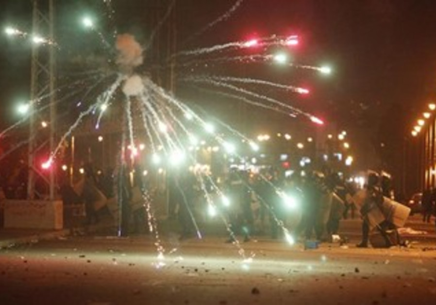 Egyptian protesters throw fireworks at police, Feb. 1, 2013