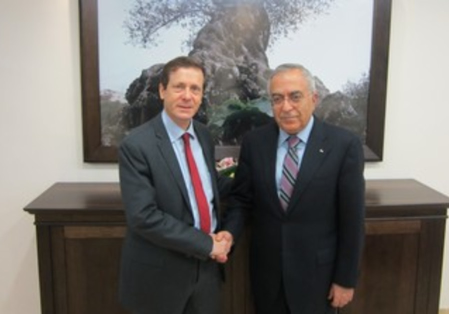 Labor MK Issac Herzog and PA Prime Minister Salam Fayyad meet in Ramallah, Feb 4, 2013