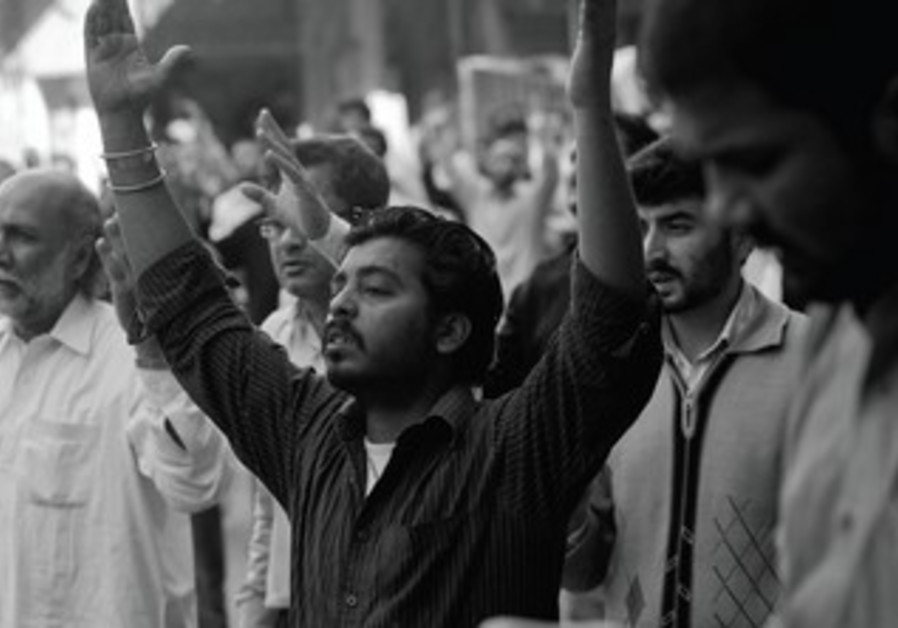 Shia Muslim men protest in Pakistan after a series of attacks on their sect.