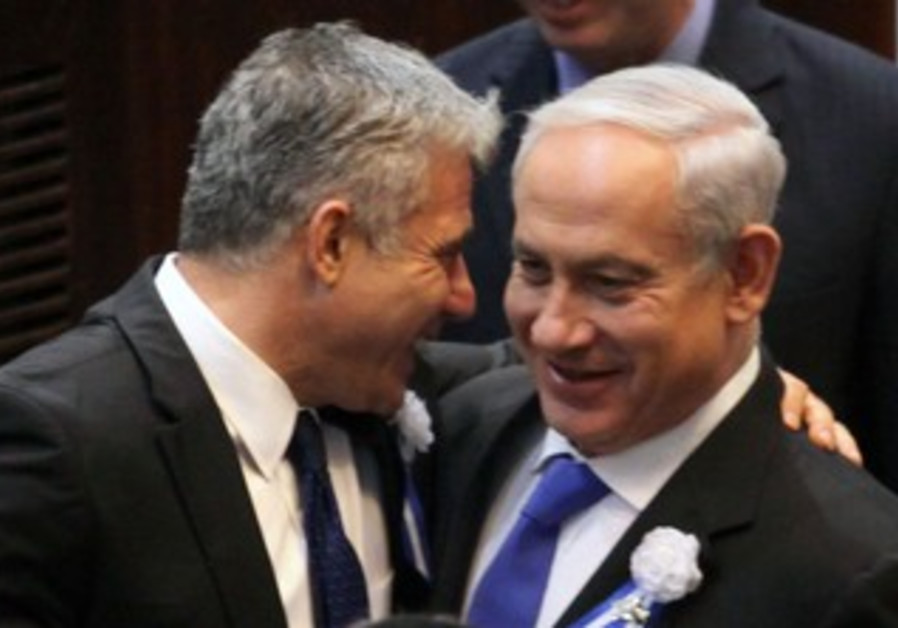 Yesh Atid leader Yair Lapid and Prime Minister Netanyahu at the Knesset swear in, February 5, 2013.