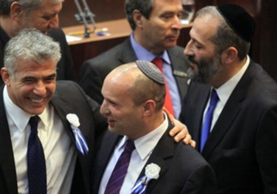 Yesh Atid leader Yair Lapid and Bayit Yehudi head Naftali Bennett at Knesset swear in, Feb 5, 2013.