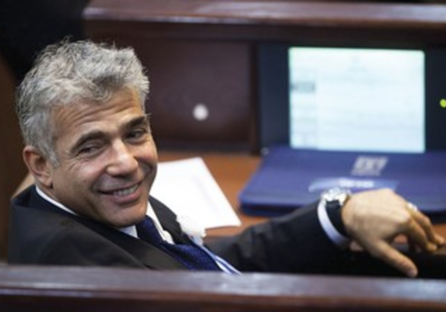 Yesh Atid leader Yair Lapid at Knesset swear in, February 5, 2013