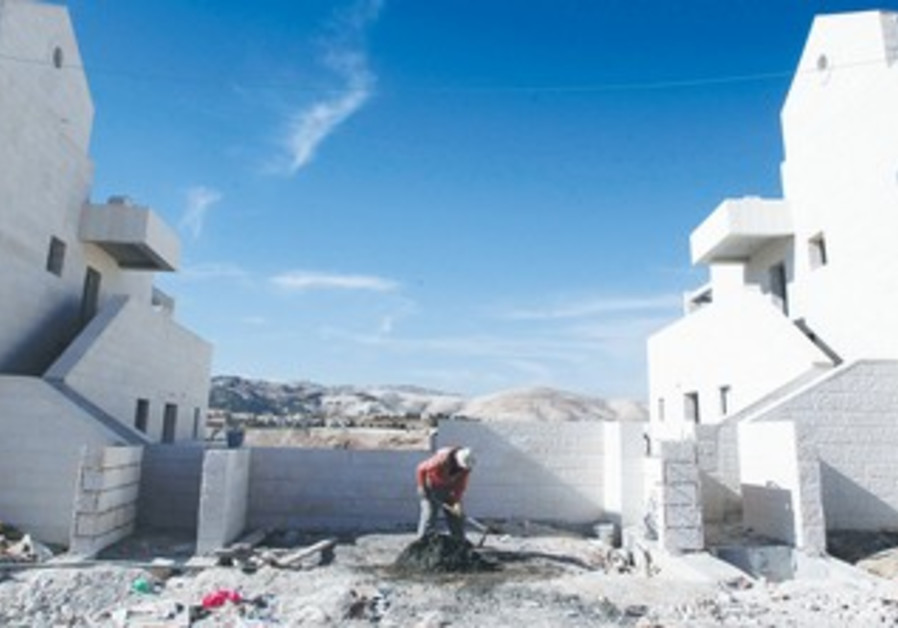 PALESTINIAN builds a home in Ma'aleh Adumim