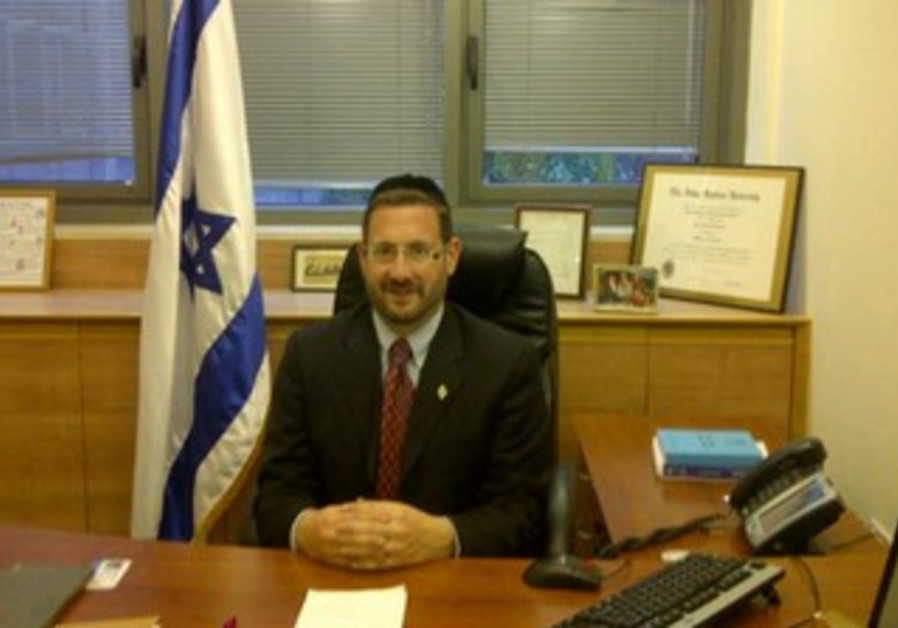 YESH ATID MK Dov Lipman in his new office.