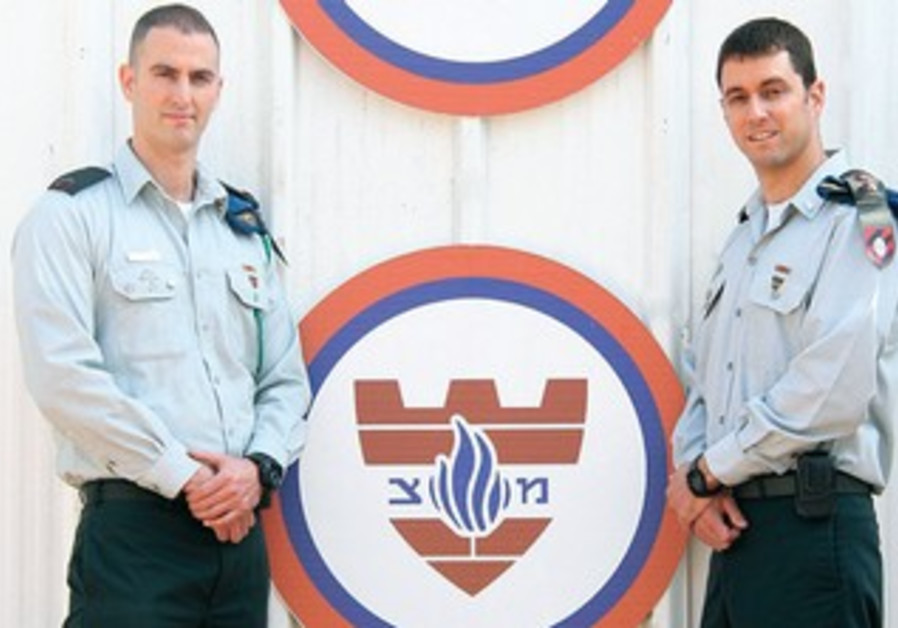 NETANEL MEIVAR (left) and his brother Avihai Meivar serve together in the military police.