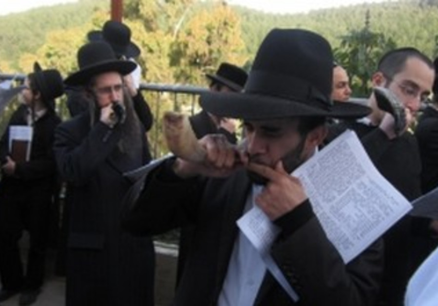 Men blowing shofars to help the unmarried find matches at the ceremony at the grave of rabbi