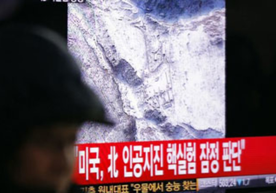 A South Korean man in Seoul watches reports of a nuclear test in North Korea, February 12, 2013.