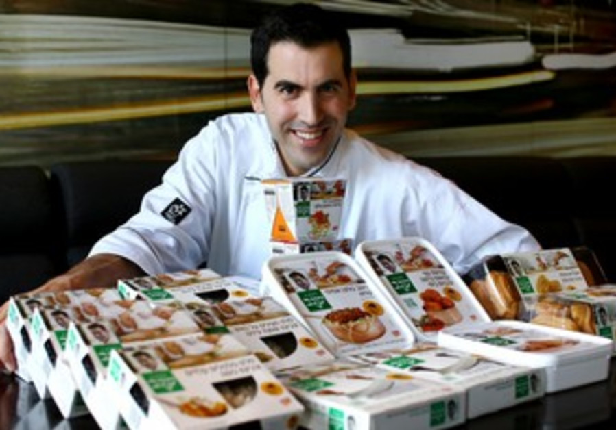 Chef Segev Moshe with his new range of meals