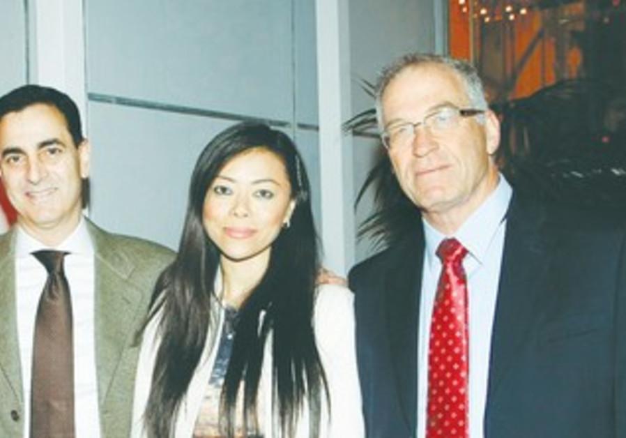 HAIM HURVITZ and his partner Naomi with Beilinson Medical Center CEO Dr. Eyran Halpern.