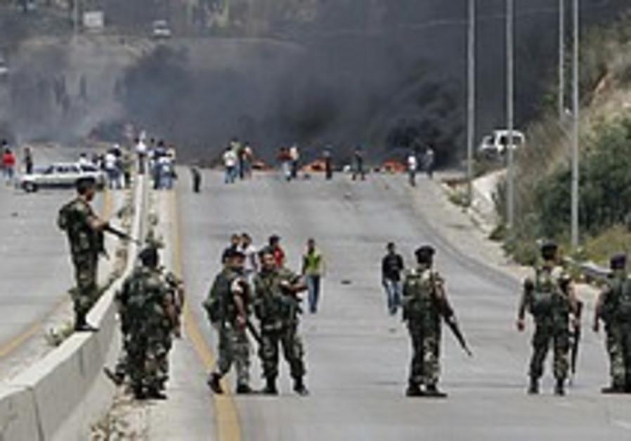 Sectarian fighting in Tripoli kills 9, wounds 50