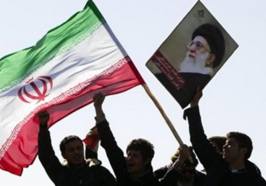Demonstrators wave Iran's flag, February 11, 2012