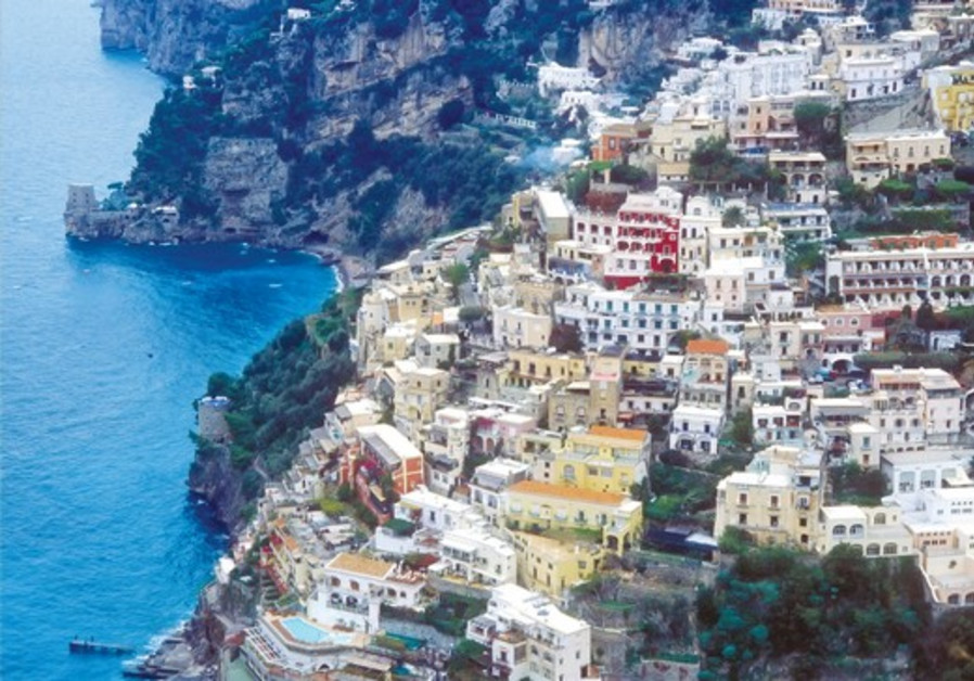 THE TOWN of Positano shines like a jewel on mountain slopes