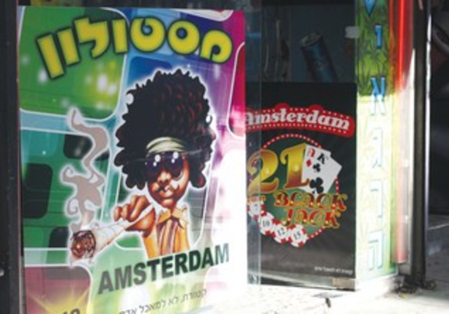 A KIOSK on TA's Allenby Street advertises synthetic marijuana.