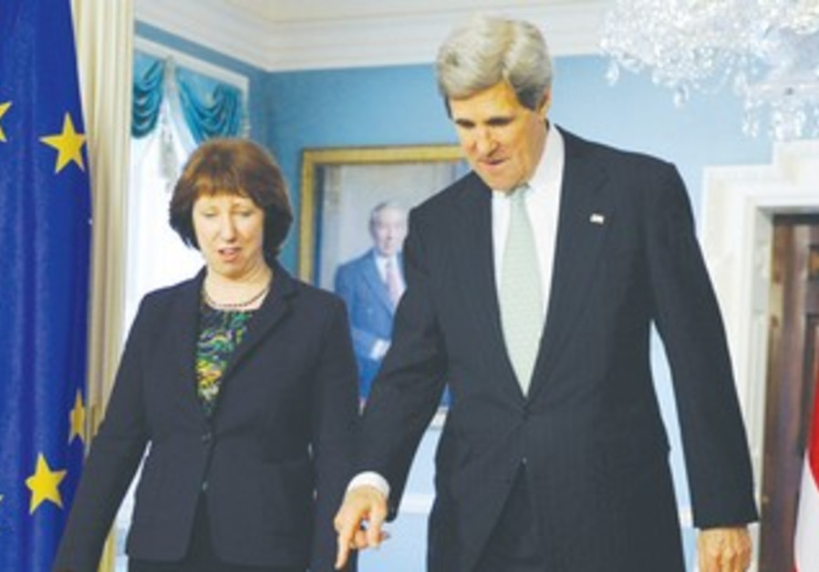 US SECRETARY OF STATE John Kerry walks with EU official Catherine Ashton in Washington, Feb 14