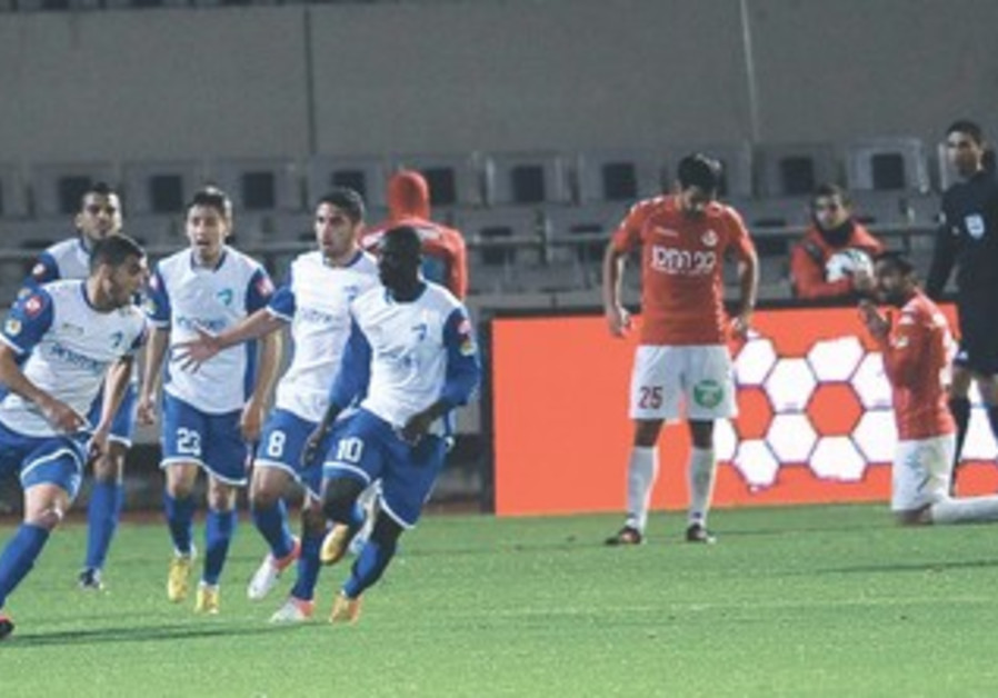 IRONI KIRYAT SHMONA players celebrate goal