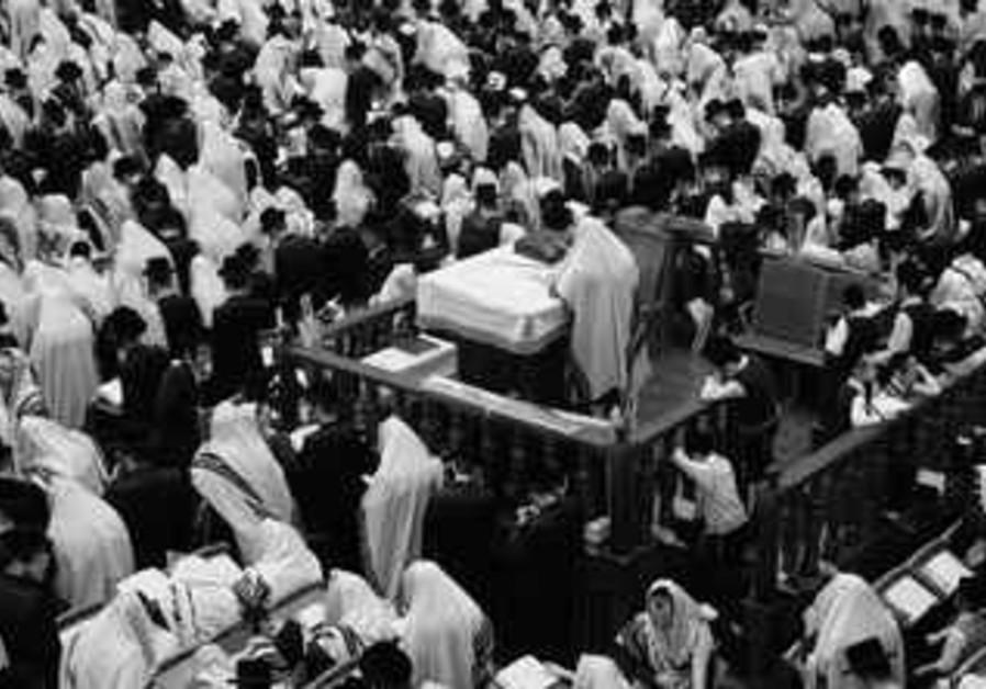 HAREDI MEN pray at the Belz Yeshiva in Jerusalem