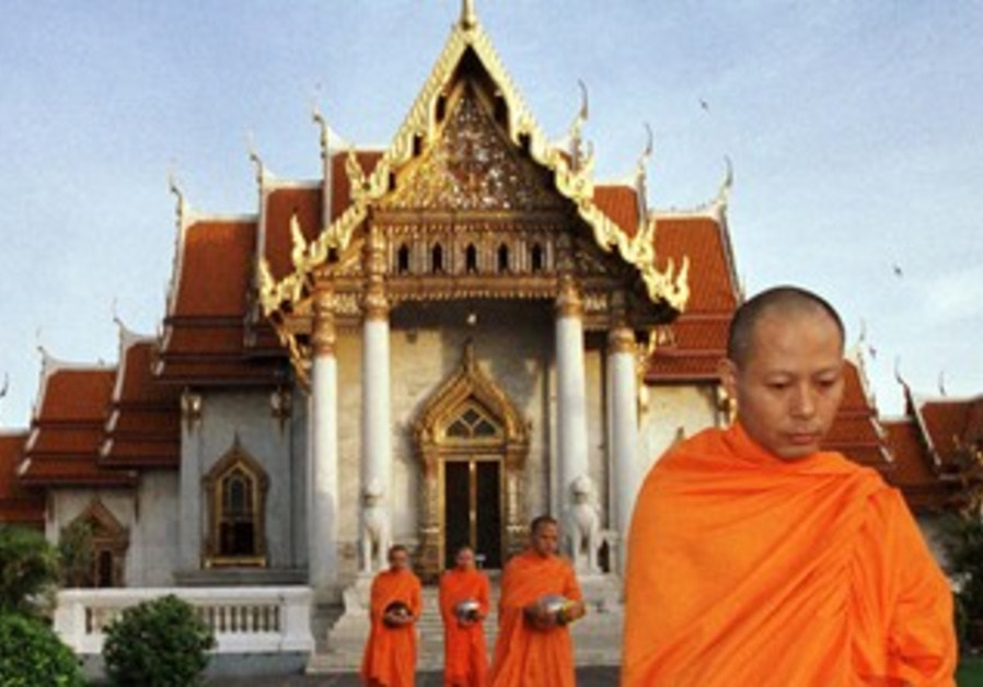 Buddhist monks leave a temple in Bangkok [file]