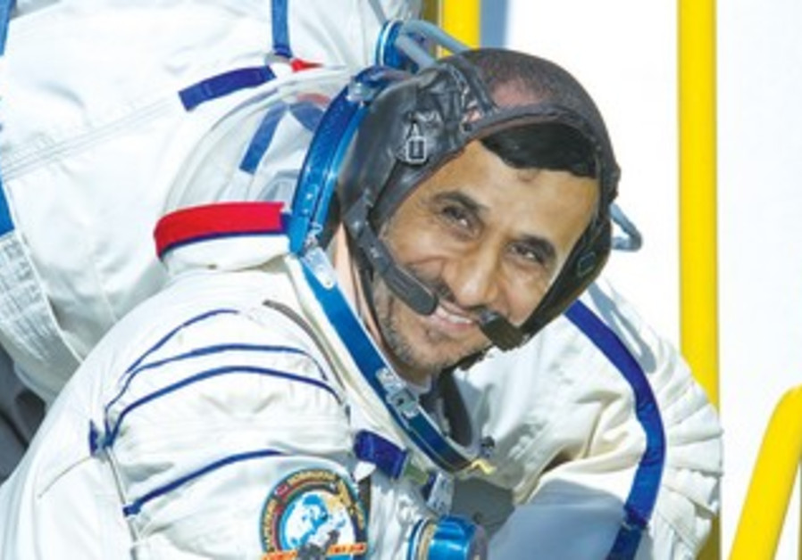 Ahmadinejad ascends into a rocket about to launch into space
