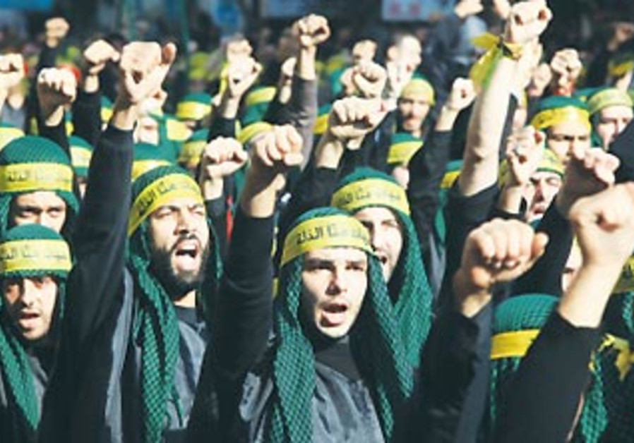 Hezbollah supporters march in Beirut's suburbs