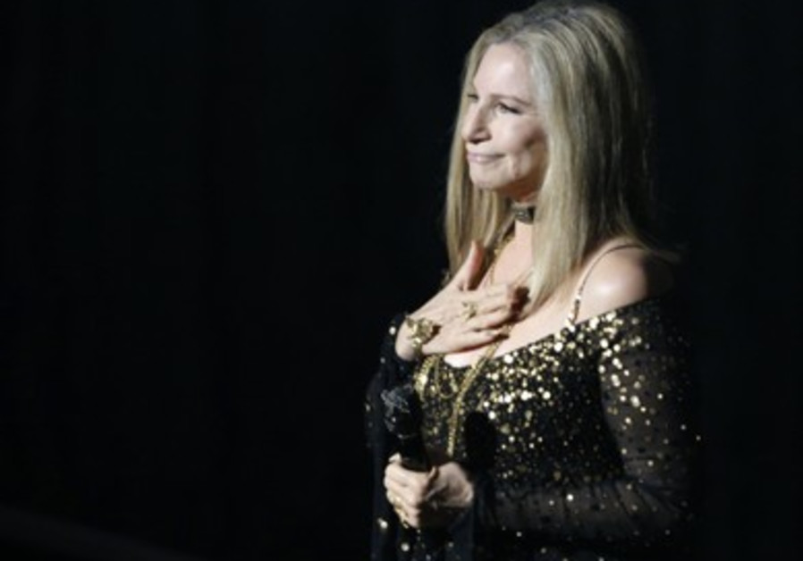Barbra Streisand accepts  applause after performing 'Memories'