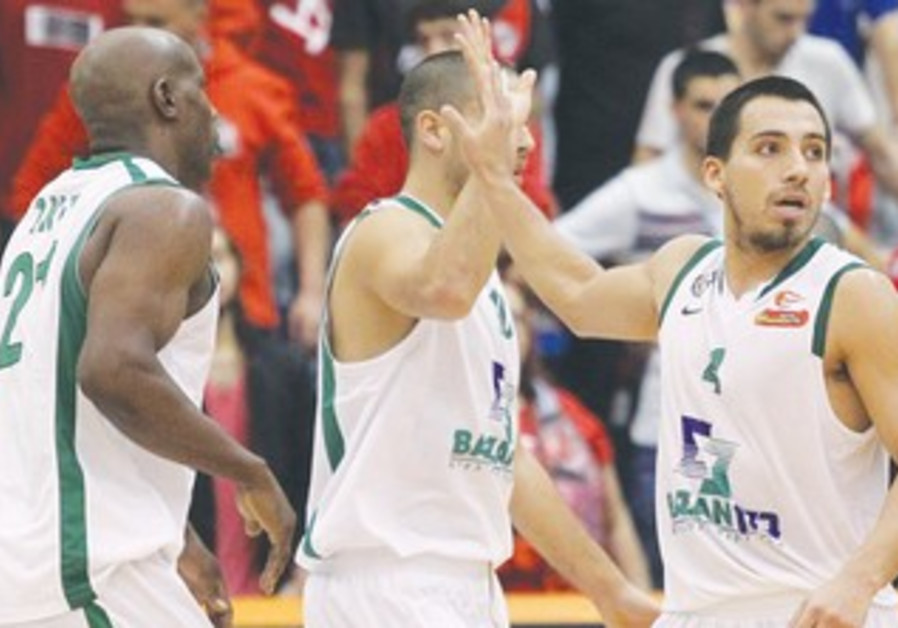MACCABI HAIFA guard Paul Stoll (R) scored 17 points, including four three pointers