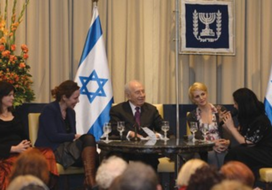 President Shimon Peres with female writers panel.