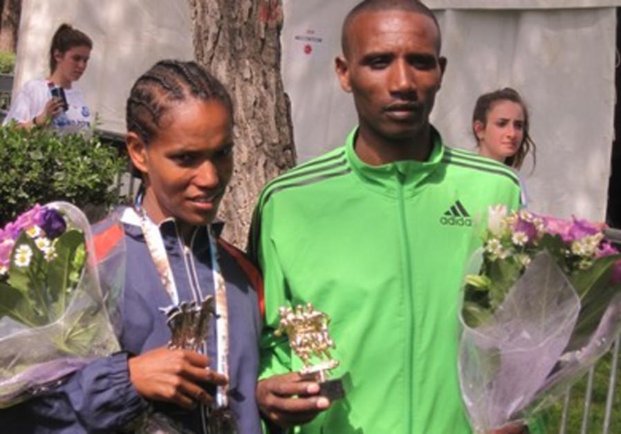 Male and female winners of the Jerusalem marathon 390