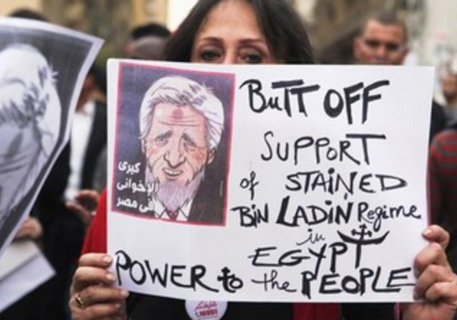 Protesters hold banners during a march towards the foreign ministry in Cairo March 2, 2013