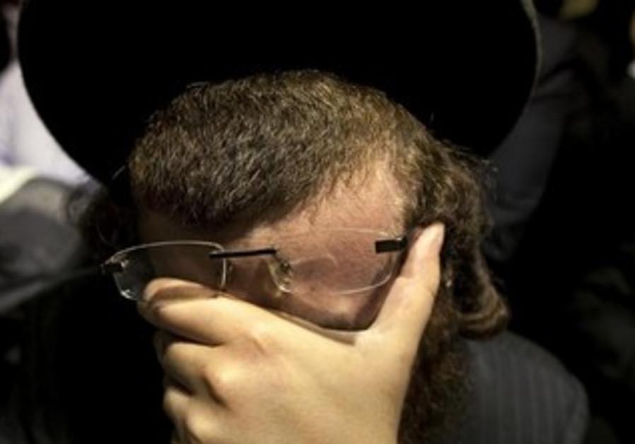 An Orthodox man weeps