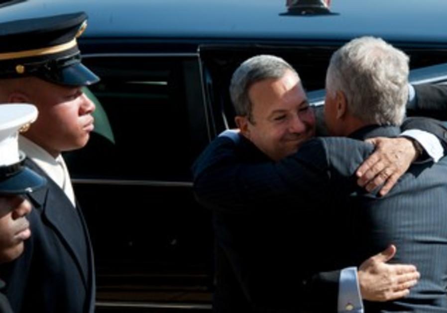 Defense Minister Barak embraces US counterpart Hagel , March 5, 2013