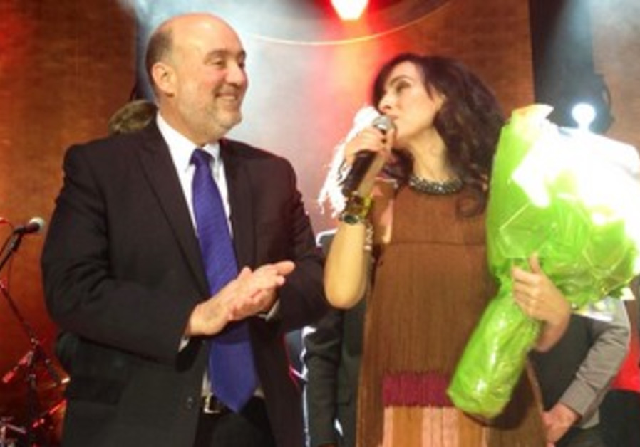 Israel envoy to the UN Ron Prosor with Israeli-Iranian singer Rita at the UN General Assembly Hall.