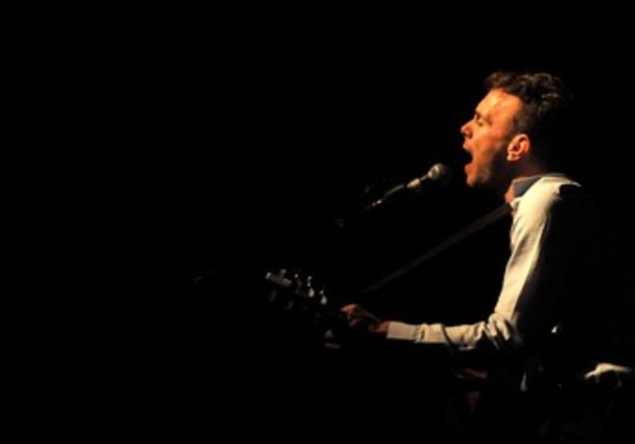 Asaf Avidan performing in Tel Aviv