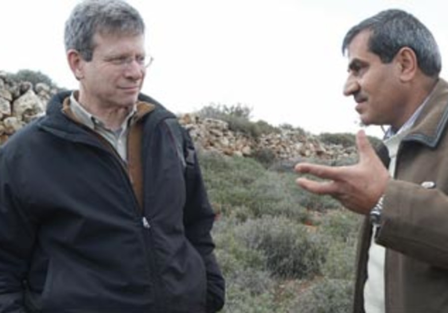 Peter Cohn chats with a Palestinian man near Qusra.