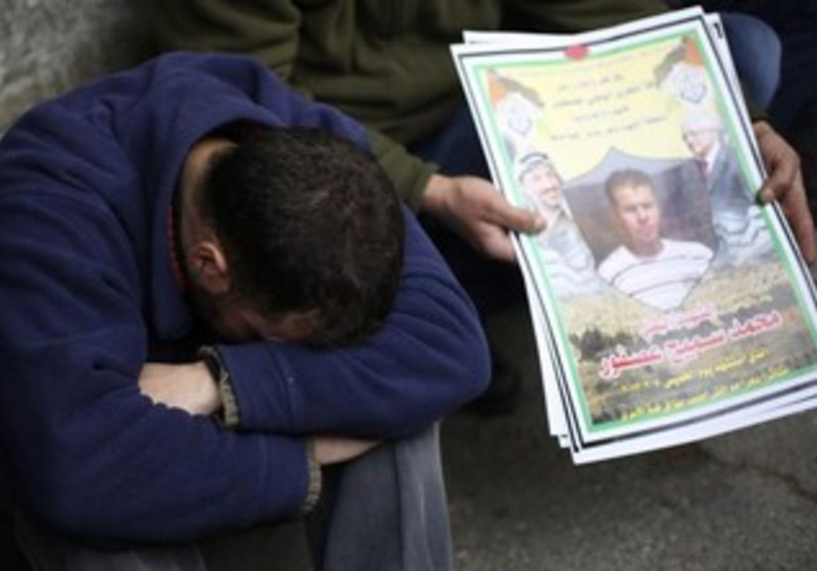 Palestinian man cries at funeral of  Muhammad Asfour, March 8, 2013.