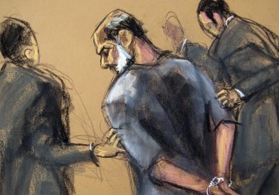 An artist sketch shows Suleiman Abu Ghaith being led in handcuffs at the US District Court in NY