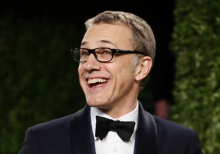 Christoph Waltz holds Oscar for best supporting actor