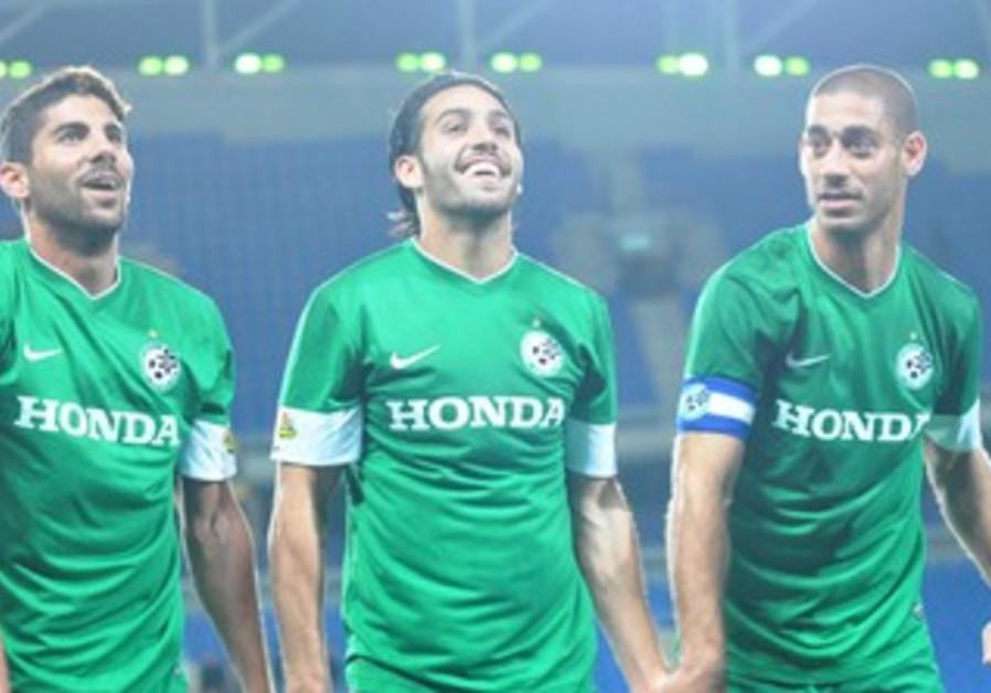 MACCABI HAIFA'S Liroy Zhairi, Eyal Golasa and Yaniv Katan (from left to right) celebrate.