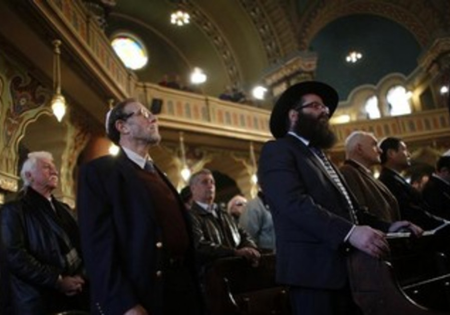 Members of the Jewish community pray during a service at the Sofia Synagogue March 10, 2013.