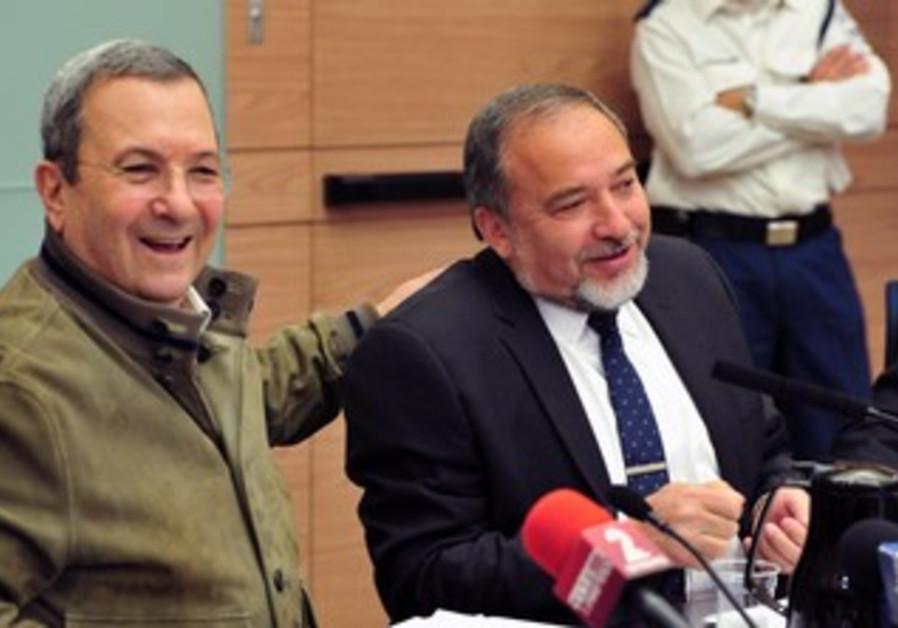 Outgoing MK Defense Minister Ehud Barak and MK Avigdor Liberman, March 11, 2013