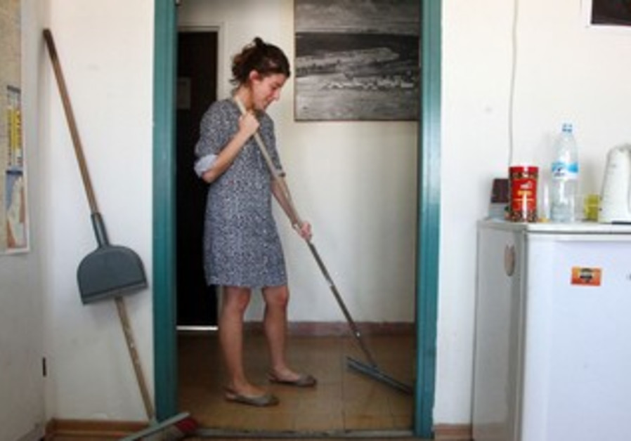 A woman cleans.