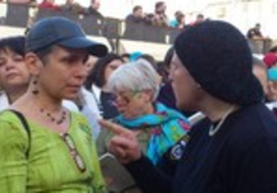 Haredi woman yells at Women of the Wall member at the Kotel