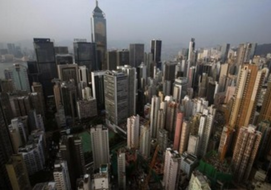 Highrise residential and commercial buildings are seen at Hong Kong island August 29, 2012.