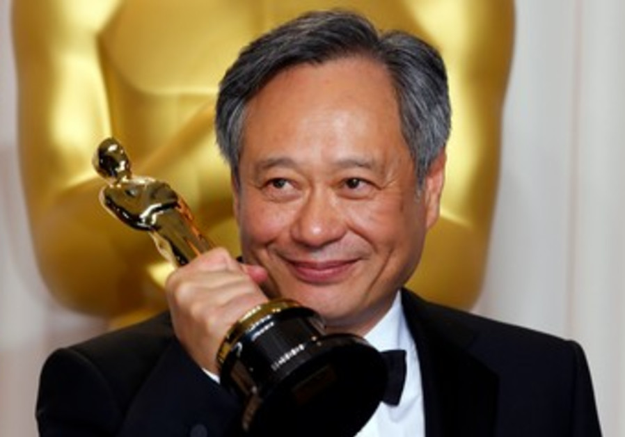 Director Ang Lee poses with his Oscar for Best Director