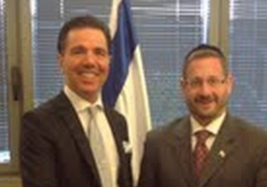 MK Dov Lipman (right) meets with Dr. Oktar Babuna,