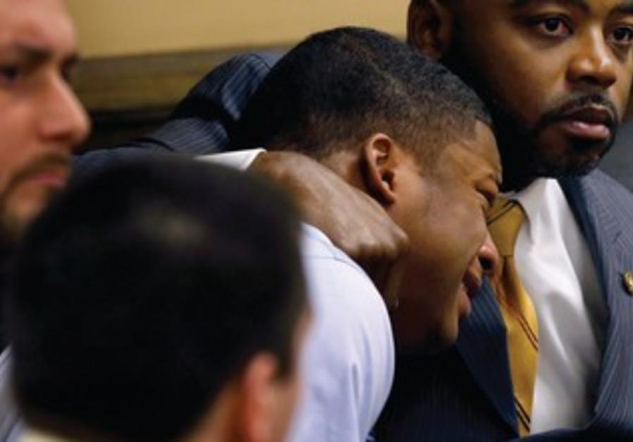 MA'LIK RICHMOND cries after hearing verdict in rape case