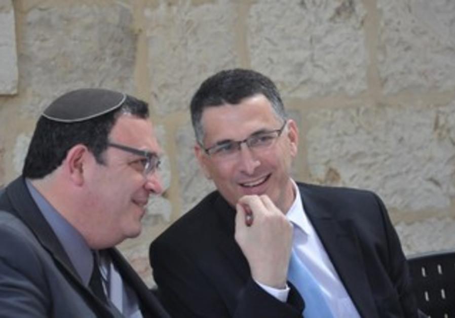 Gideon Sa'ar (R) hands over education Ministry to Shai Piron